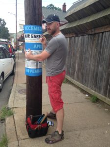 Picture of Pole with Signage being installed